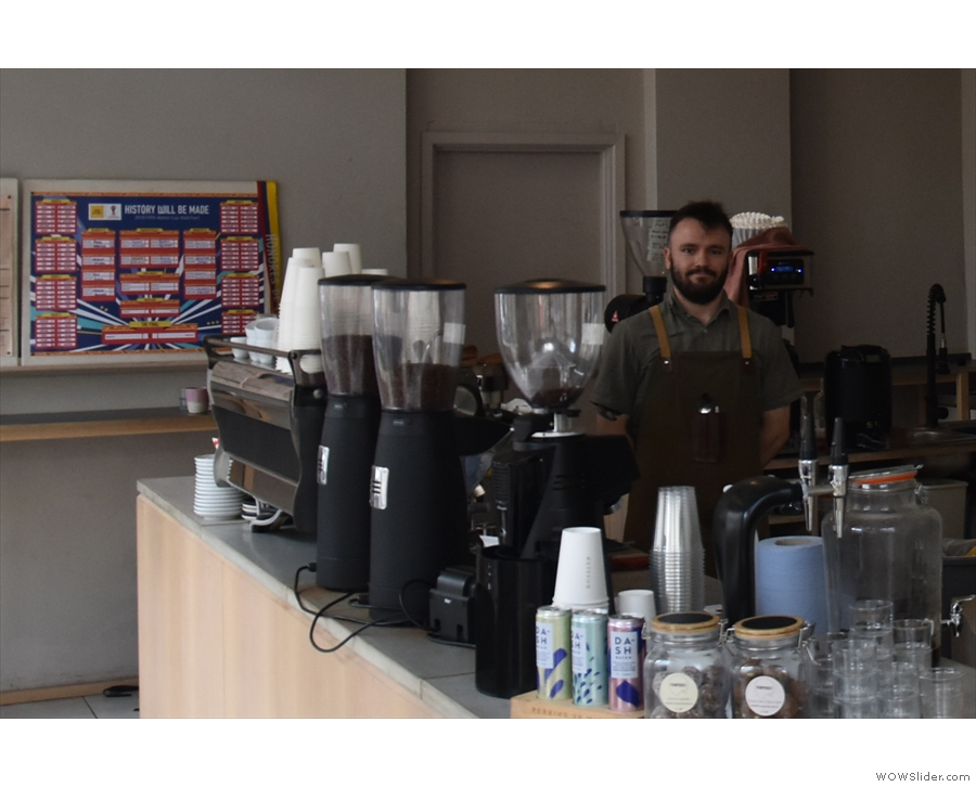 ... while the espresso machine, and a very proud barista, are at the other end.