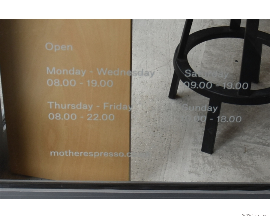 The opening times are on the bottom of the door, visible, but not very prominent.