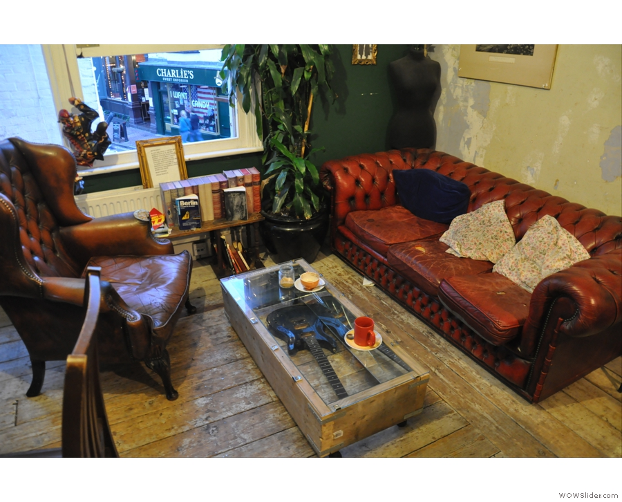 What a gorgeous sofa and armchair. Loving the guitar/table too :-)