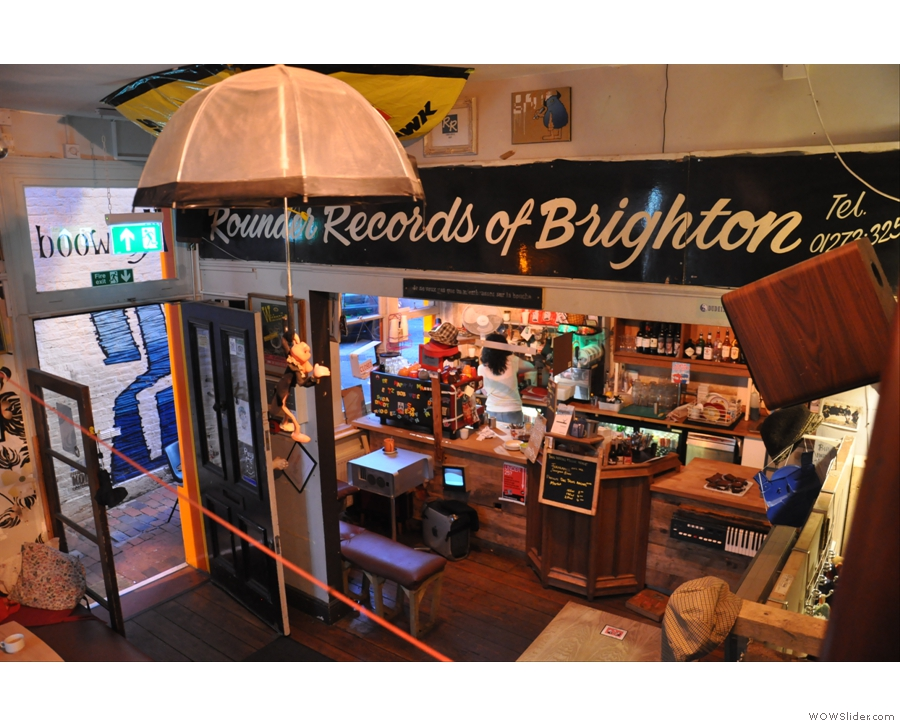 While the Pink Pather parachutes to earth. The Rounder Records sign was recycled when the store closed last year.