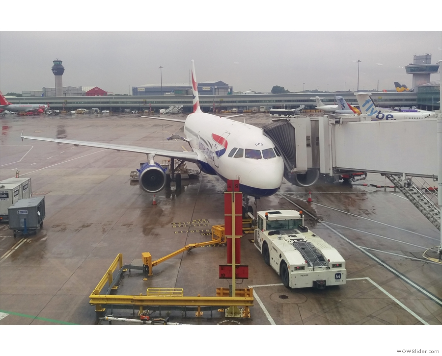 My ride down to Heathrow, an Airbus A319, on the stand at Manchester Airport T3.