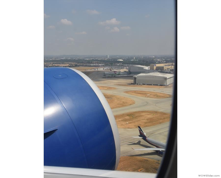 Heathrow quickly falls away below us.