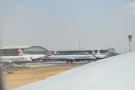 We swing around at the end of the runway. That's Terminal 5 behind us.