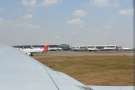 Waiting at the end of the runway.