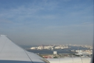 Haneda is to the south of Tokyo on a spur of land surrounded by docks.