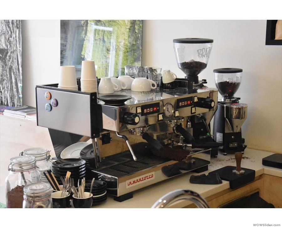 The La Marzocco Linea espresso machine is at the front of the counter...