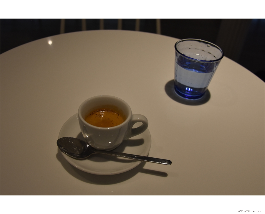 My espresso, served with a glass of sparkling water on the side.