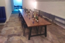 Turning left (towards the back) there's a large space with this communal table...