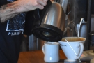 Water is added to a cone, much like a V60...