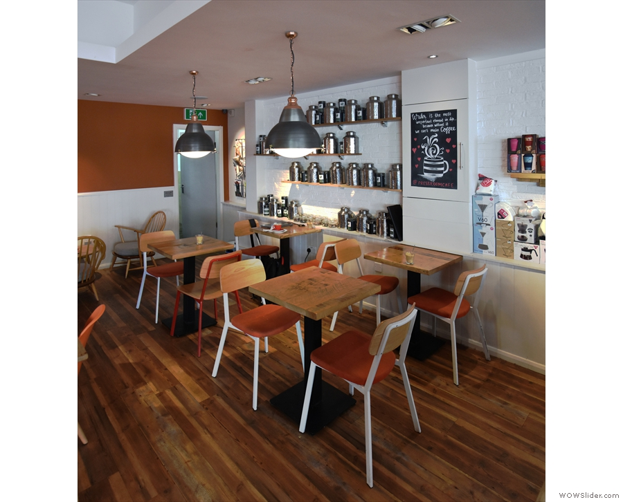 ... and a square of four two-person tables with chairs off to the right.