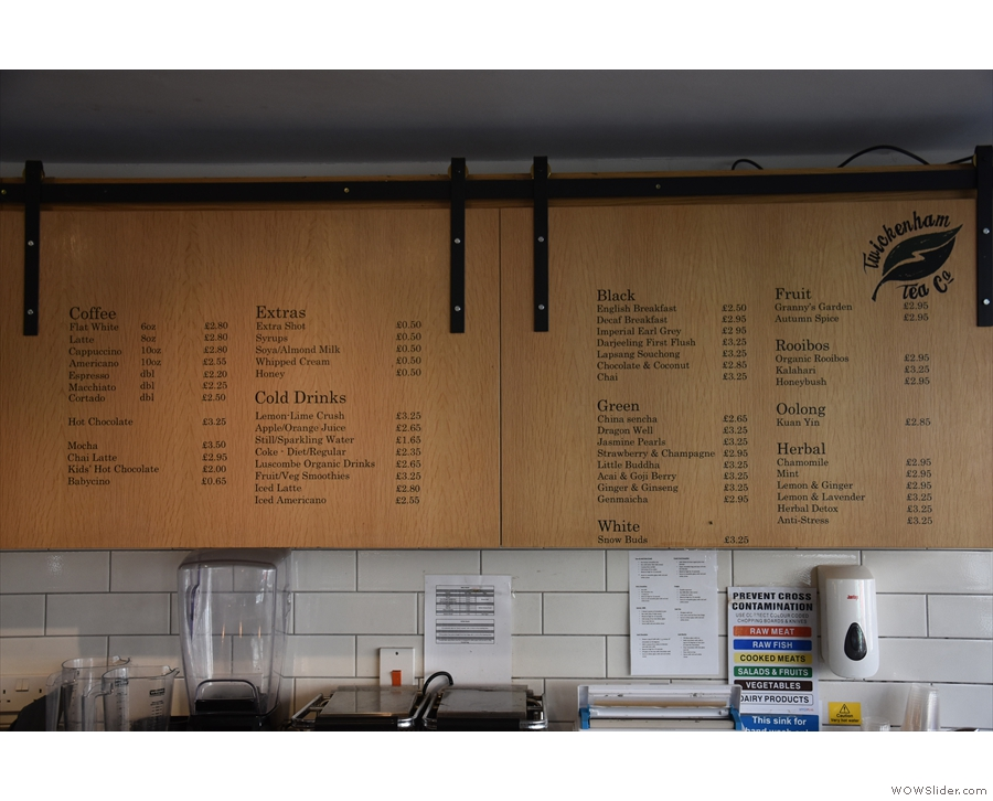 The menu is on the wall behind the counter.
