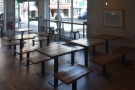 There's also a cluster of fixed, wooden tables with short, wooden benches.