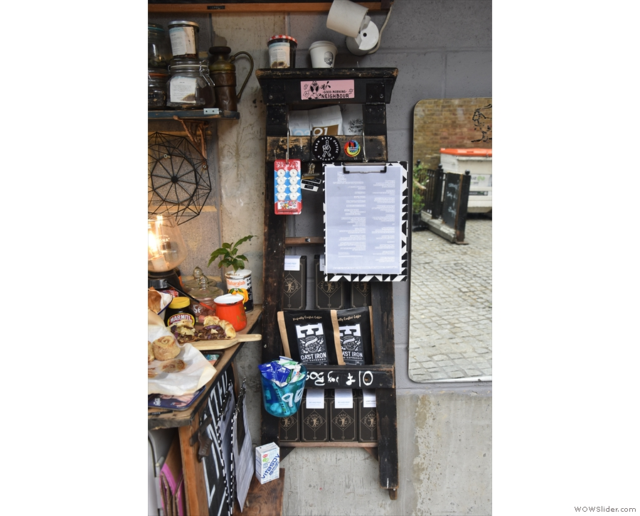 In the middle, directly opposite as you enter, there are retail bags of coffee...