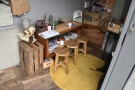 ... with these three low stools by a cluttered table...