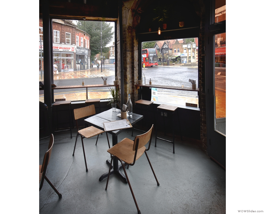 The corner window-bar, with the square table in the foreground.
