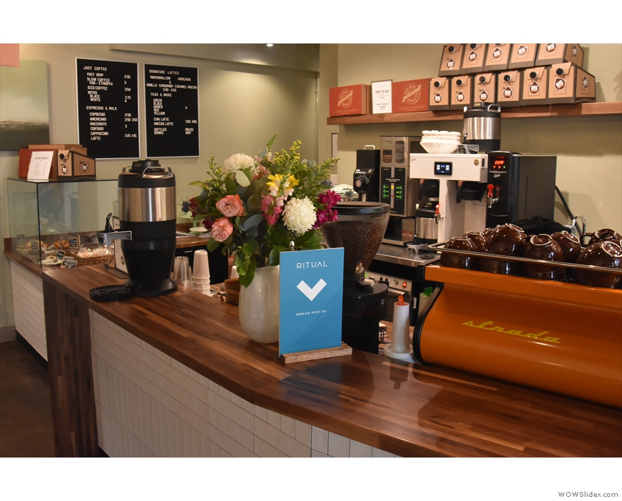 The rear end of the counter, where all the coffee magic happens.