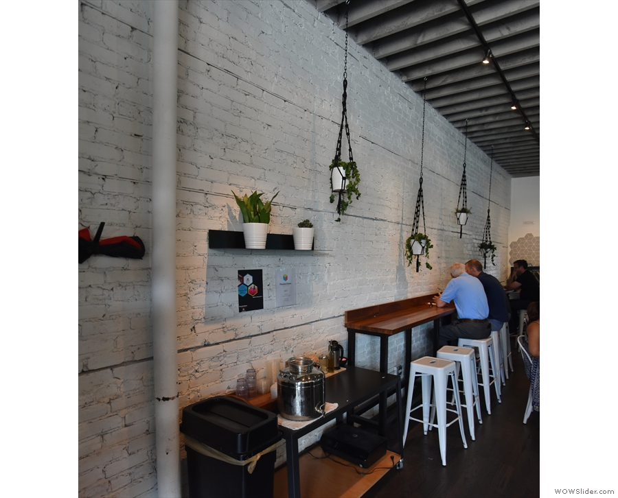There's an eight-person bar along the left-hand wall with high bar stools...