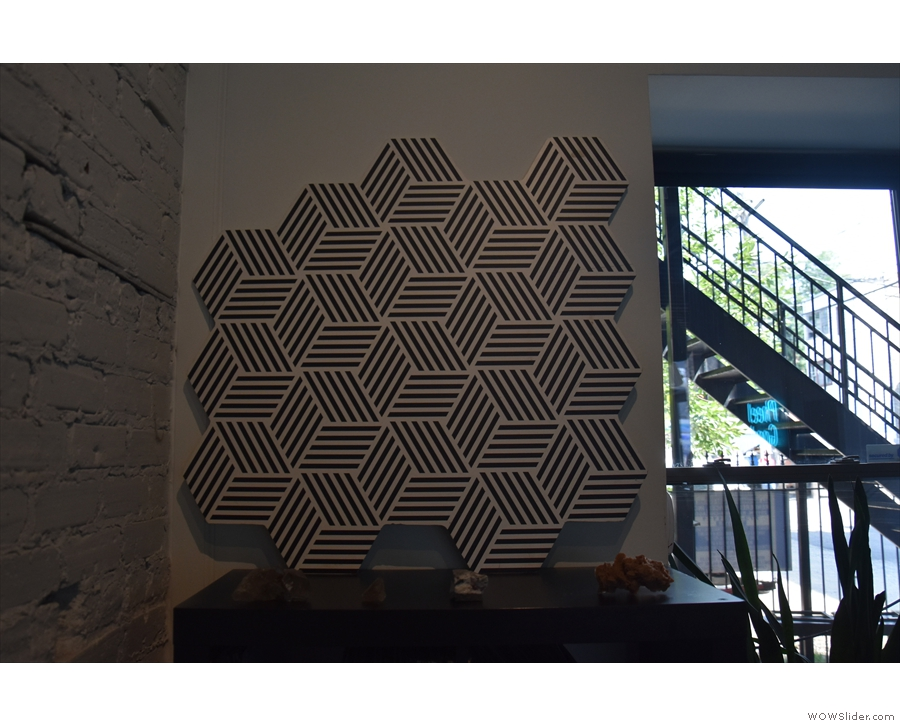... while what I took to be a hexagon pattern on the wall is, in fact, the cube logo again.