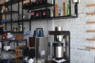 The batch-brew filters and kettles for the tea are on the wall behind them...