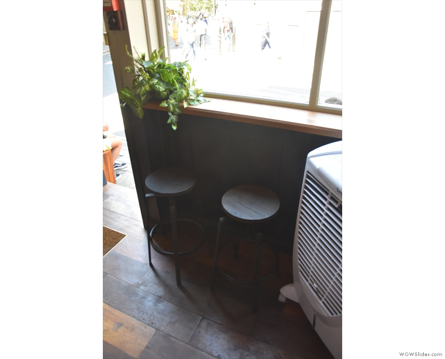 Meanwhile. on the left, there is another pair of bar stools...