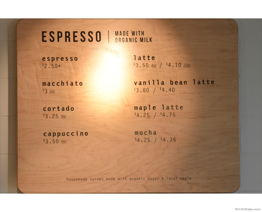 The actual coffee menu is on the wall to the right, above the retail shelves...