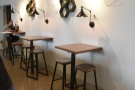 There are also three high tables against the back wall.