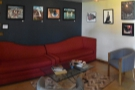 ... with this large, red sofa against the wall, plus a pair of round armchairs.