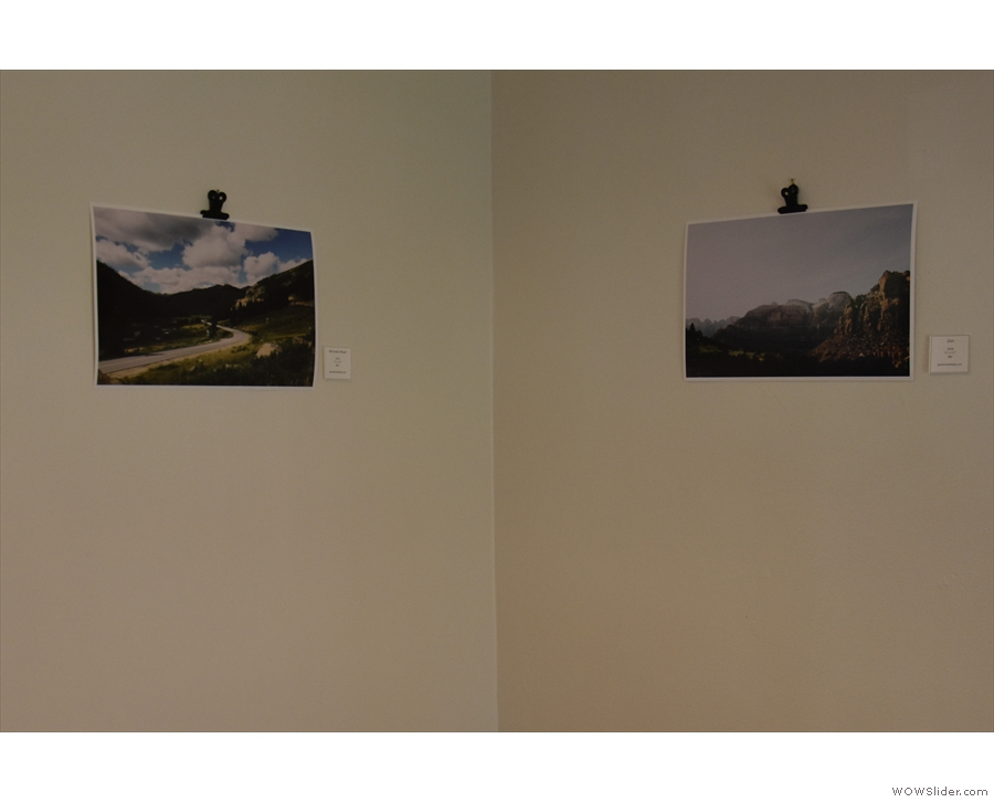 The walls are fairly plain, although there are various works of art adorning them...