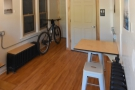 This is a large, spacious room, with bike storage and a rest-room at the back.