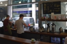 ... with the baristas at work at the far end of the counter by the takeaway window...