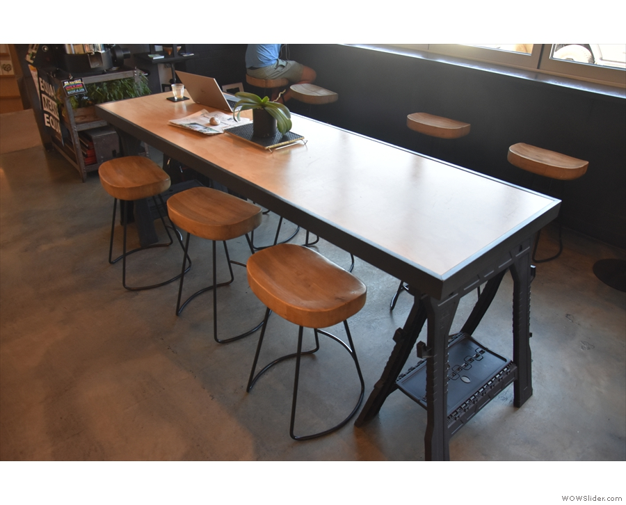 It has six of these really comfortable, broad-topped stools, with three on each side.