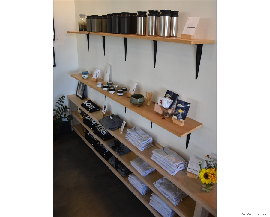 There are various pieces of pottery, plus the usual merchandising, on the retail shelves...