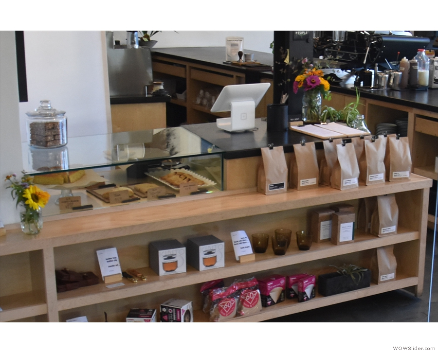 ... while there are bags of coffee for sale on shelves in front of the counter.