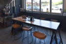 The seating is centred on this large, communal table in the centre of the room...