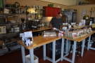 Although a roastery, you can buy coffee to drink. The till is at the front of the counter...