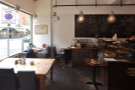 There's  more seating at the front on the left beyond the communal table, where...