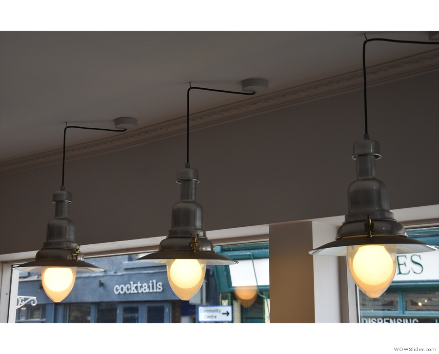 There are also some glass-clad bulbs: these hang above the window-bar...