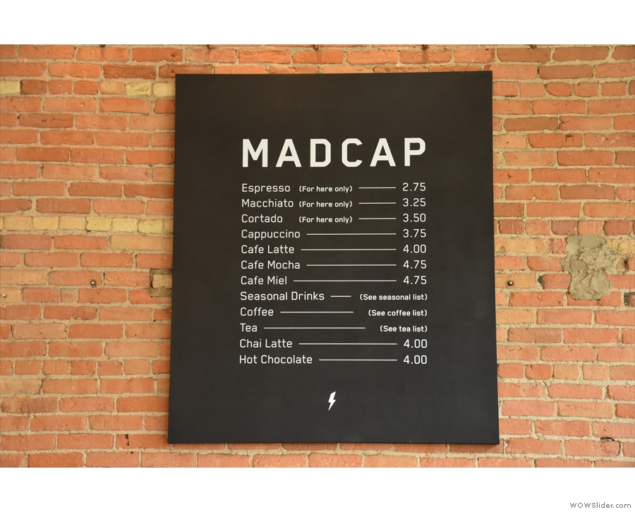 Meanwhile, the main coffee menu is on the wall behind the counter...