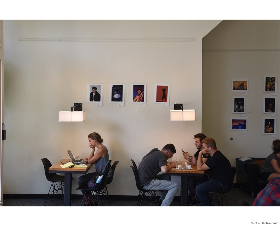 There are two four-person tables against the left-hand wall, with a sofa beyond...