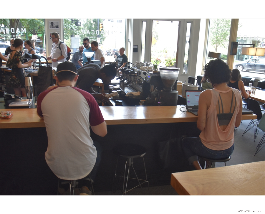 ... while there's more seating along the left-hand side of the counter.