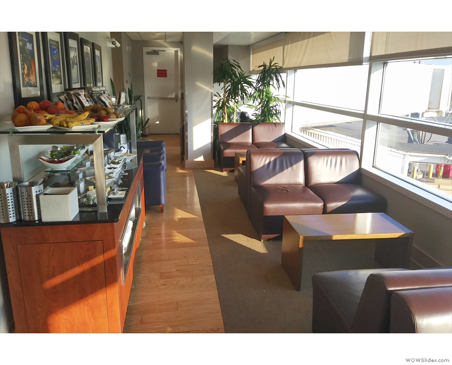 The seating consists of sets of four comfortable chairs lining the windows.