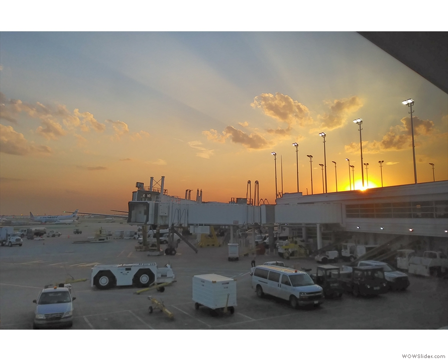 I sat watching the planes and writing postcards untl the sun set behind the gate. Going...