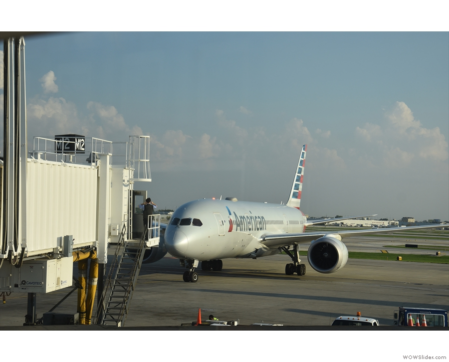 Meanwhile, off to the other side, an American Airlines flight is just arriving at Gate M12.