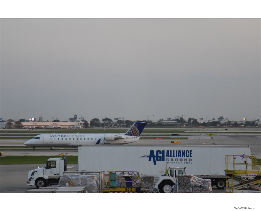 If you want an idea of size, here's a United Bombardier CRJ-200 next to a large truck...