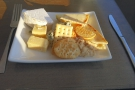Knowing that I would be eating later, I helped myself to cheese and biscuits.