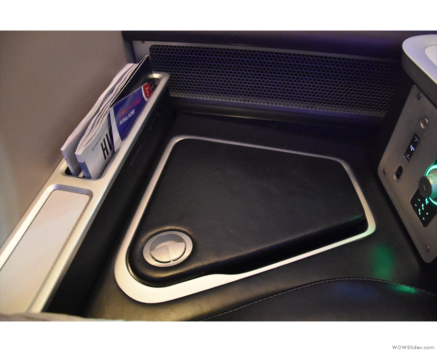 There's more storage by the seat itself. This opens up...