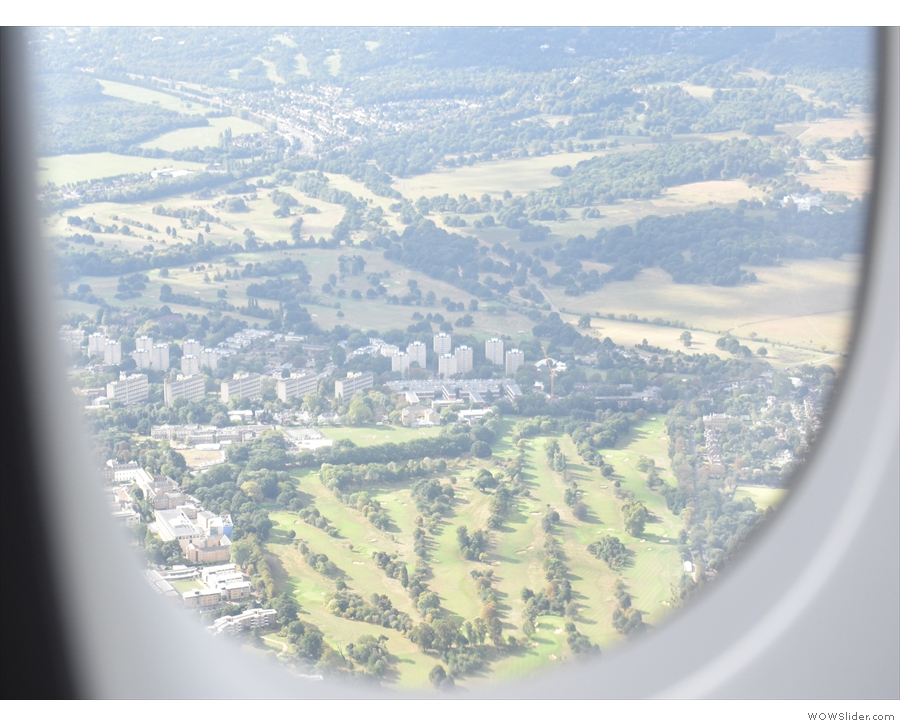 That's definitely Roehampton Golf Club in the foreground, with Richmond Park beyond.