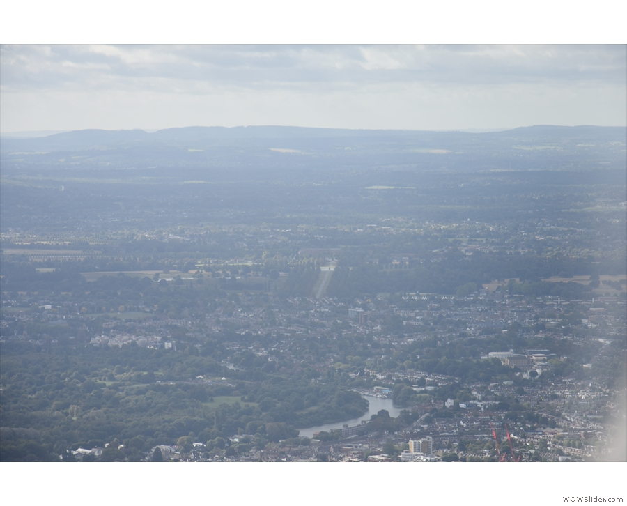 The Thames, with the North Downs on the horizon, probably the area around Dorking.