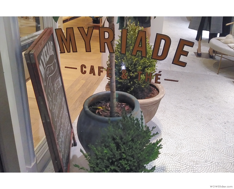There aren't many external signs of Café Myriade & the A-board was hiding from the rain!