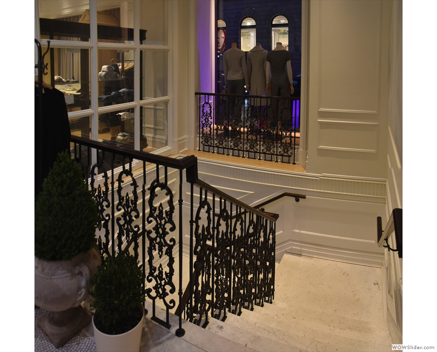 ... a broad, elegant staircase which leads down, doubling back on itself...